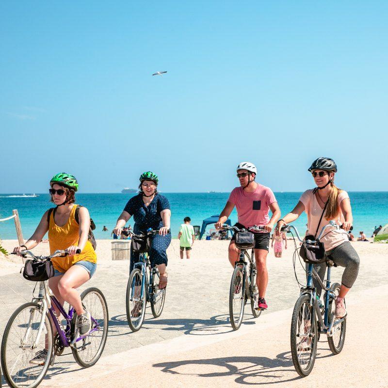 a group of friends biking