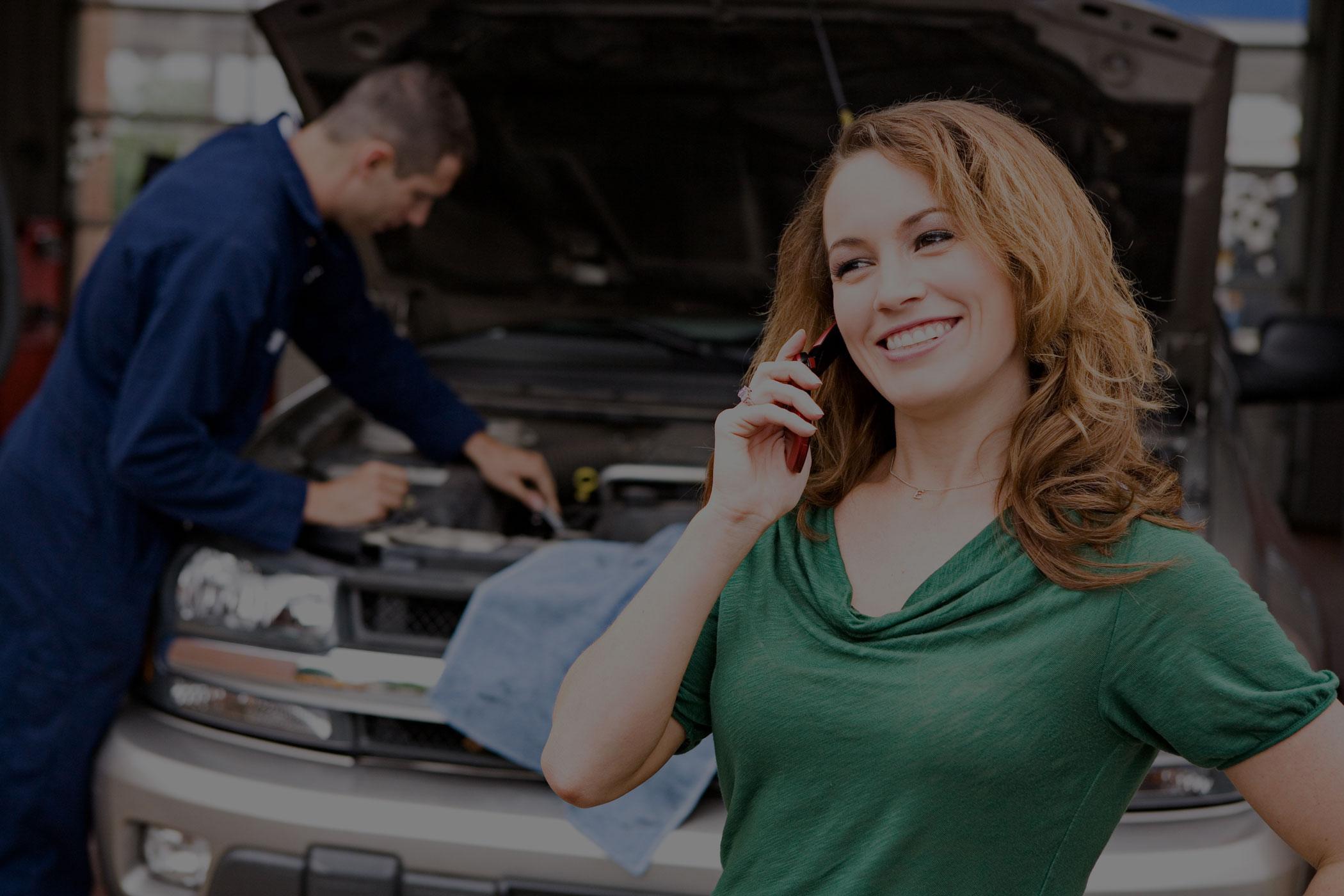 woman in garage talking on phone smiling