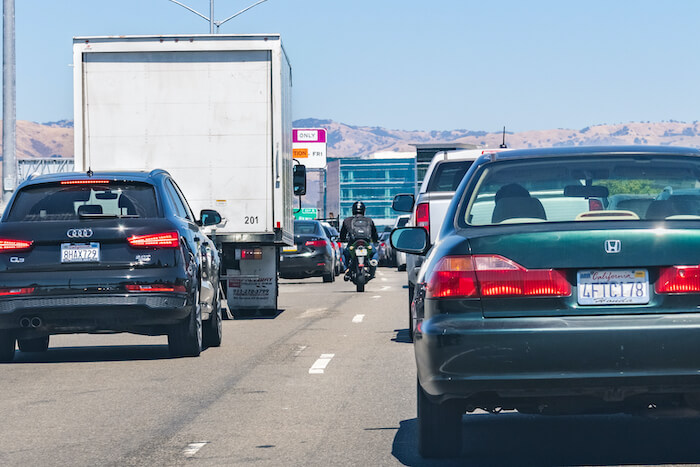 Lane splitting, also commonly referred to as white lining or stripe riding, occurs when a motorcyclist, bicyclist, or the operator of another two-wheeled vehicle drives between lanes of slow-moving cars that are moving in the same direction