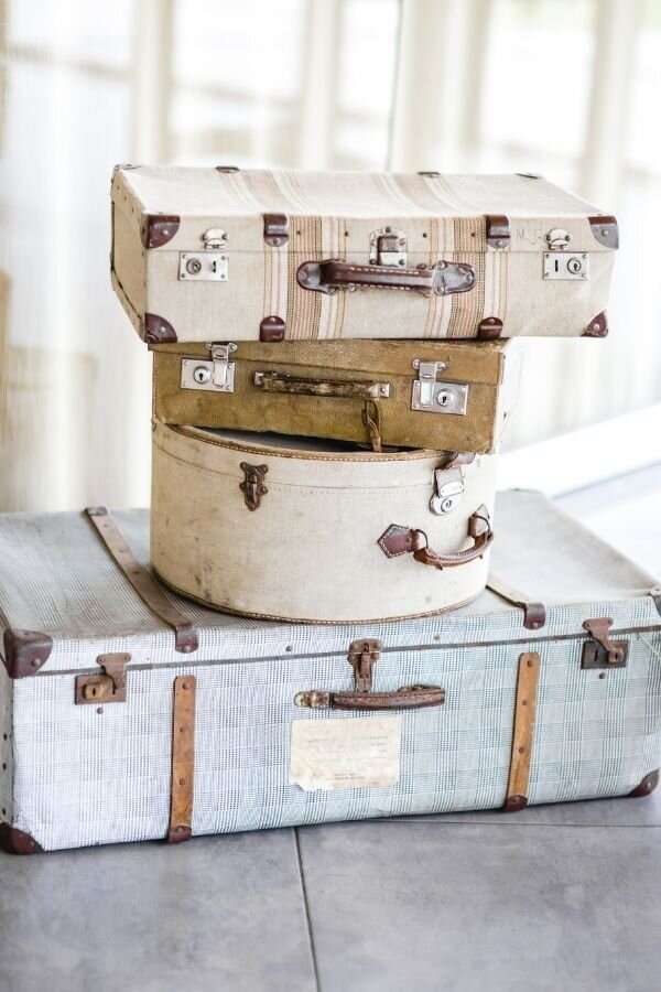 vintage suitcases and hat box