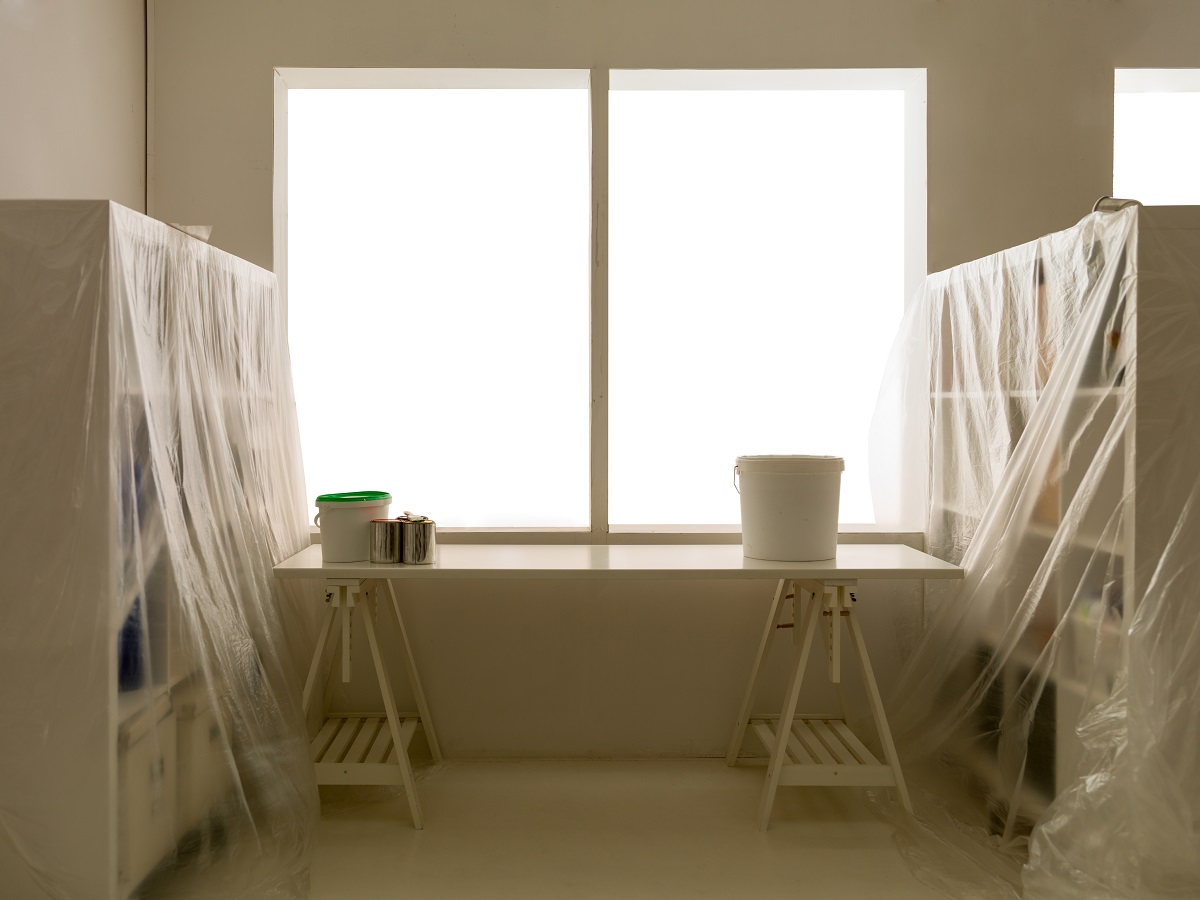 furniture covered with plastic sheets