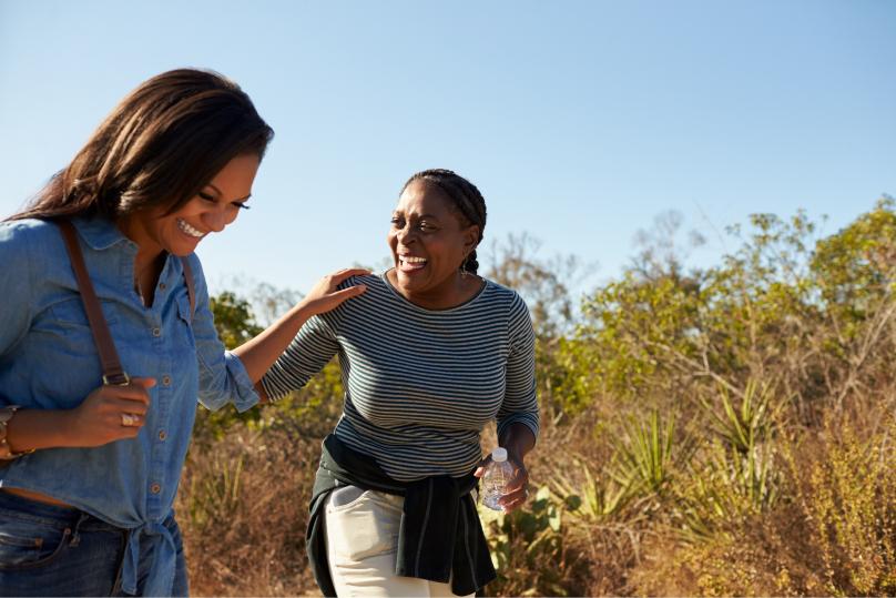 Friends hiking through a field.
