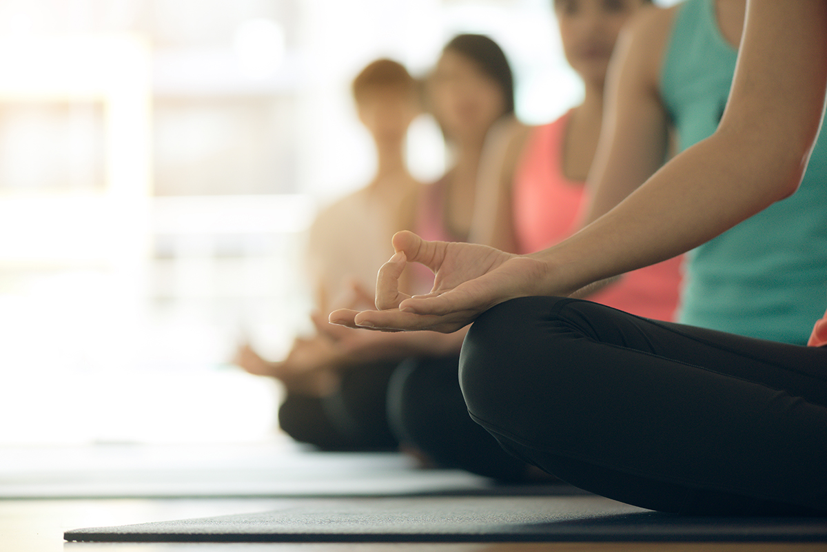 Young women yoga indoors keep calm and meditates while practicin|yin-yoga