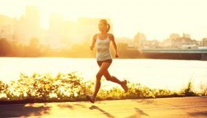 female runner running at sunset in city park. Healthy fitness woman jogging outdoors. Montreal skyline in background.; Shutterstock ID 83732998; PO: The Huffington Post; Job: The Huffington Post; Client: The Huffington Post; Other: The Huffington Post