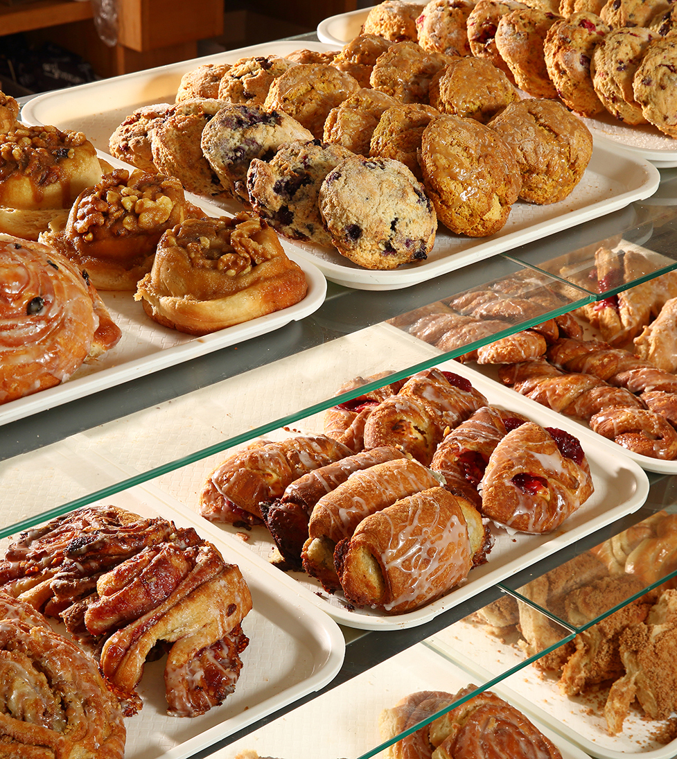 This is a display case with shelves of pastries.