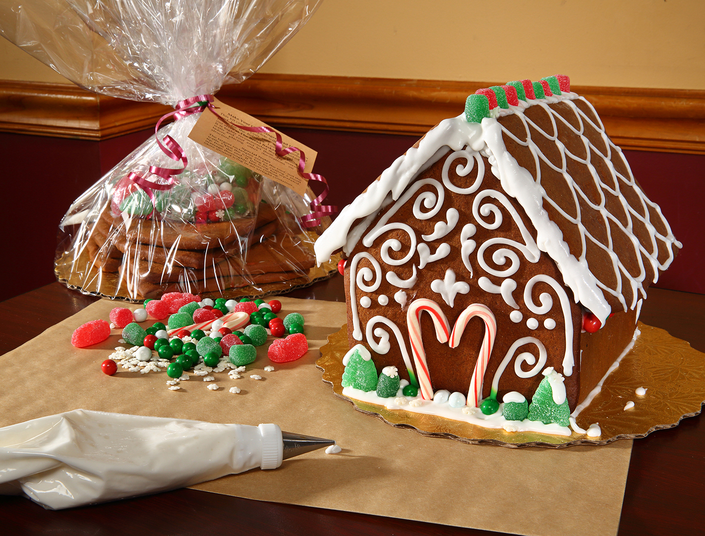This is a warm photo of gingerbread houses as they are being frosted.