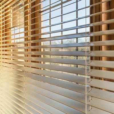 sun streaming through open blinds