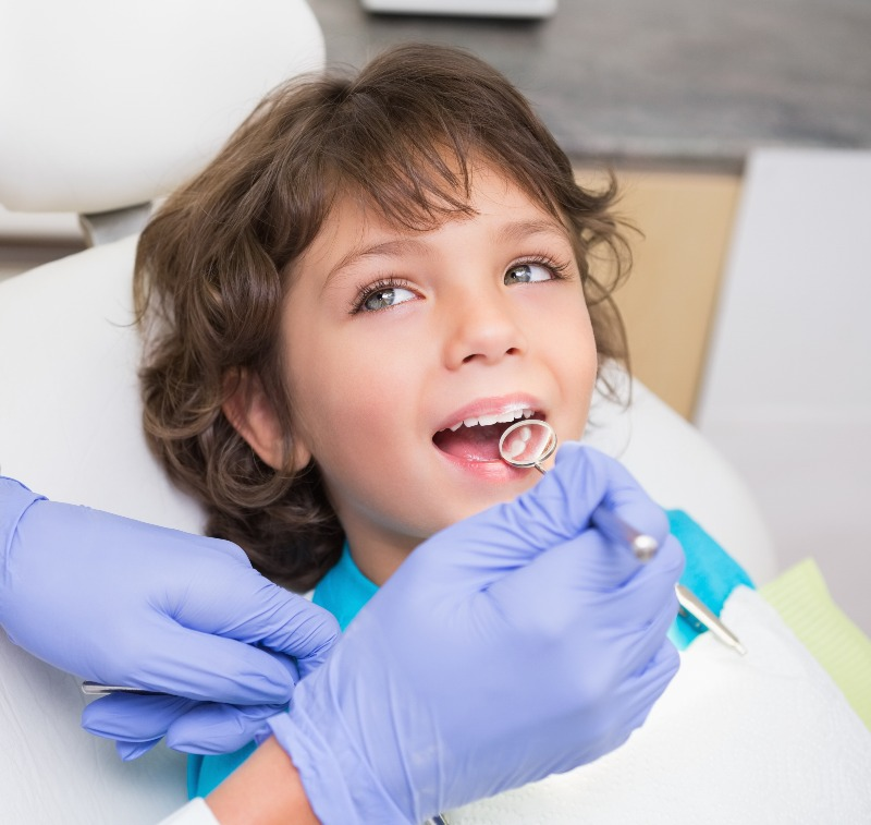 kid in dental chair