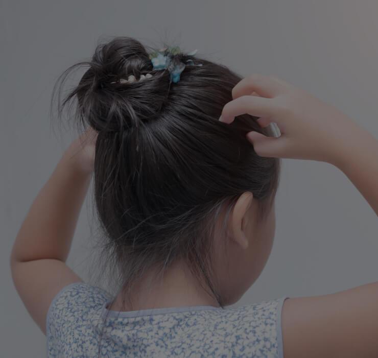 girl scratching her head