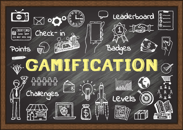 A blackboard image with words like gamification, leaderboard, points, levels and badges.
