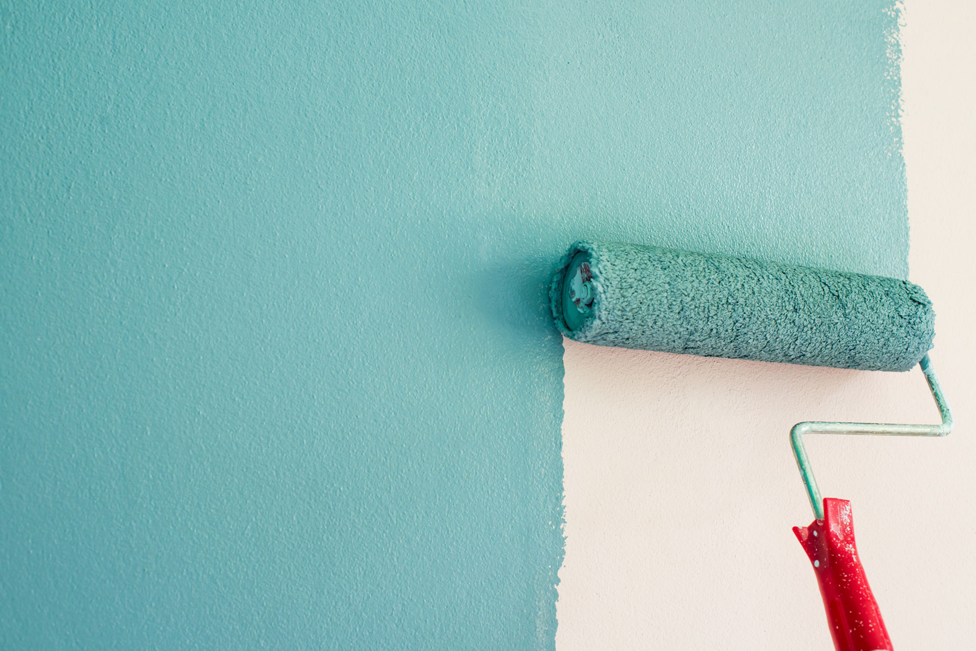 Painting of walls in a blue colour. Repair in a house.