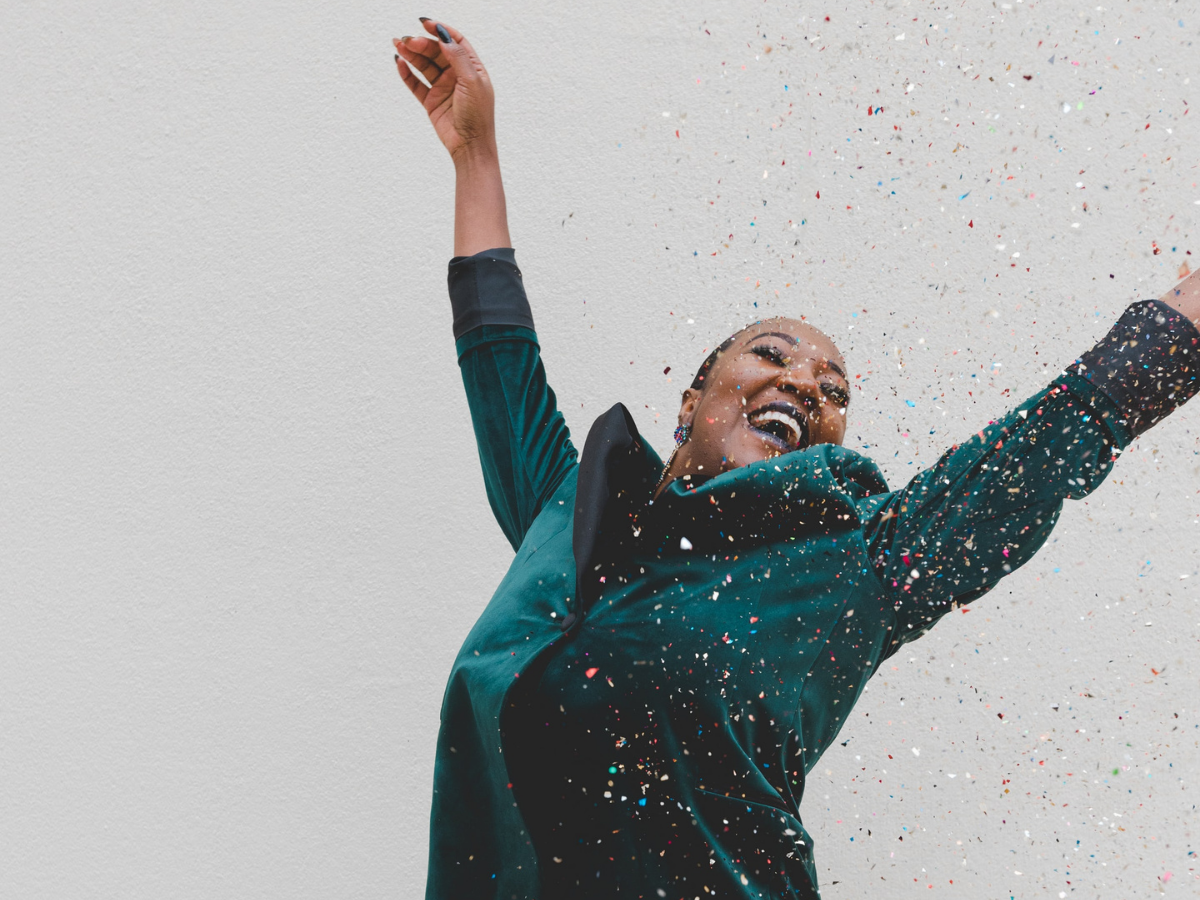a woman celebrating with confetti