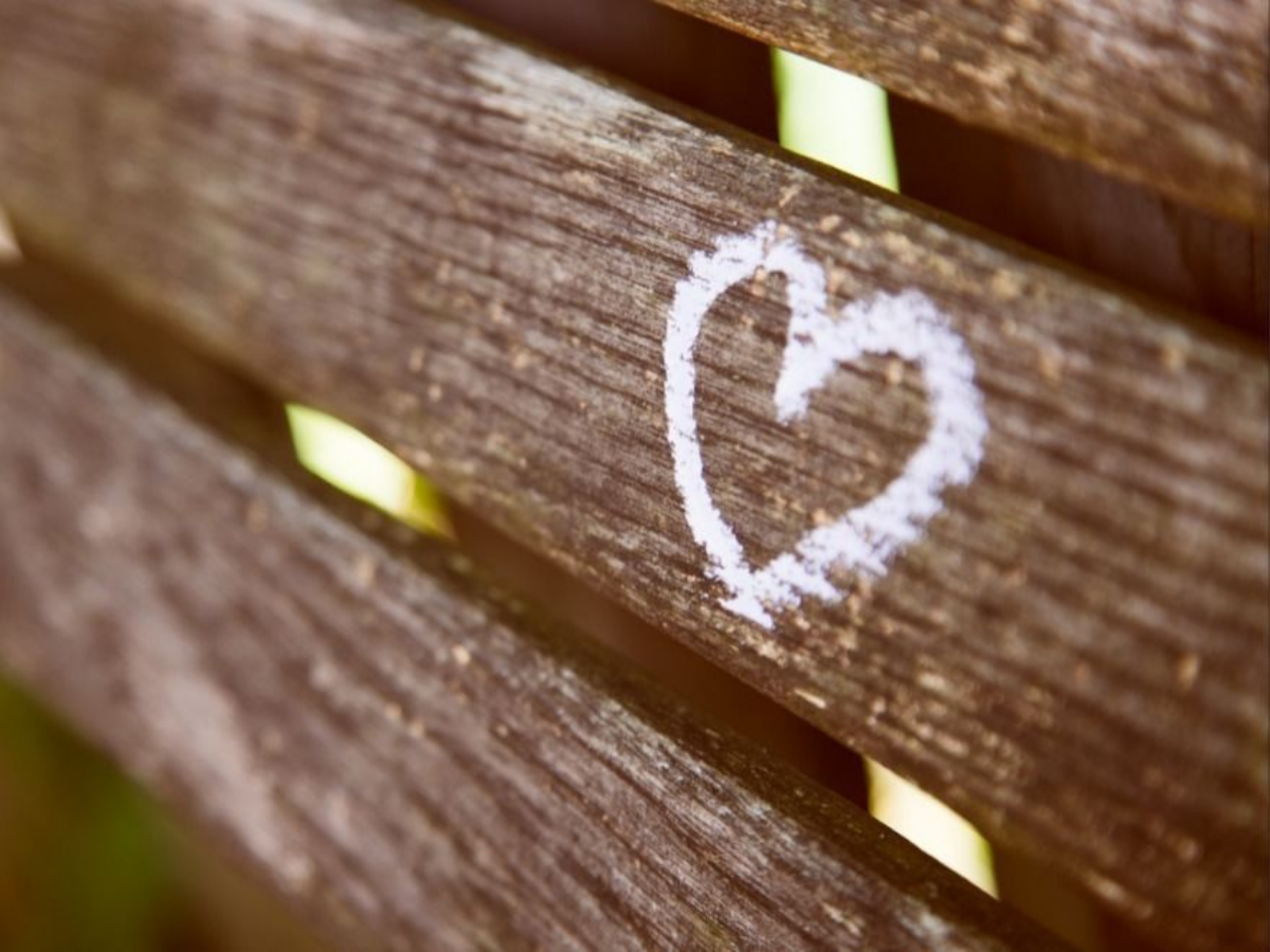a heart painted on a wooden fence