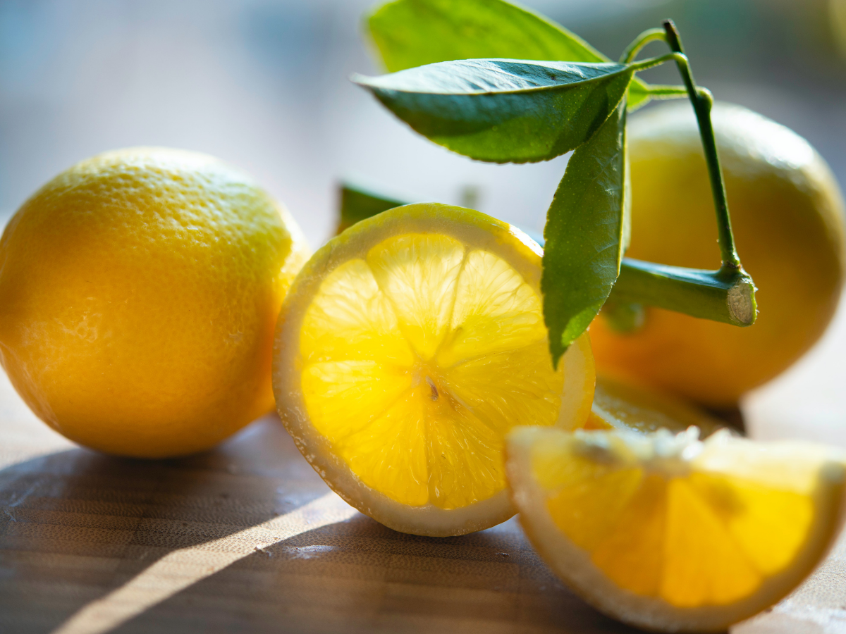 a few lemons with one sliced open