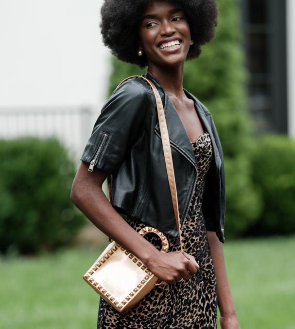 A woman carrying a mini-handbag.