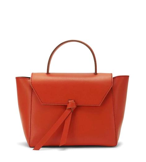 An orange mini-handbag.