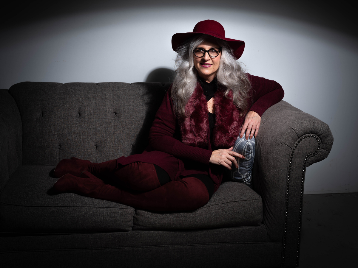 Stylish older woman on a couch.