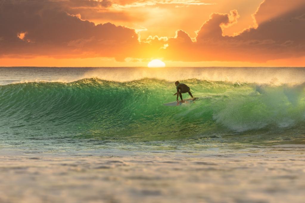 Surfer Surfing at Sunrise
