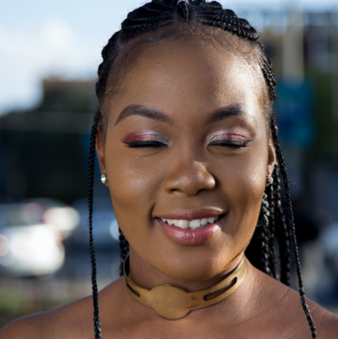 black woman smiling with her eyes closed