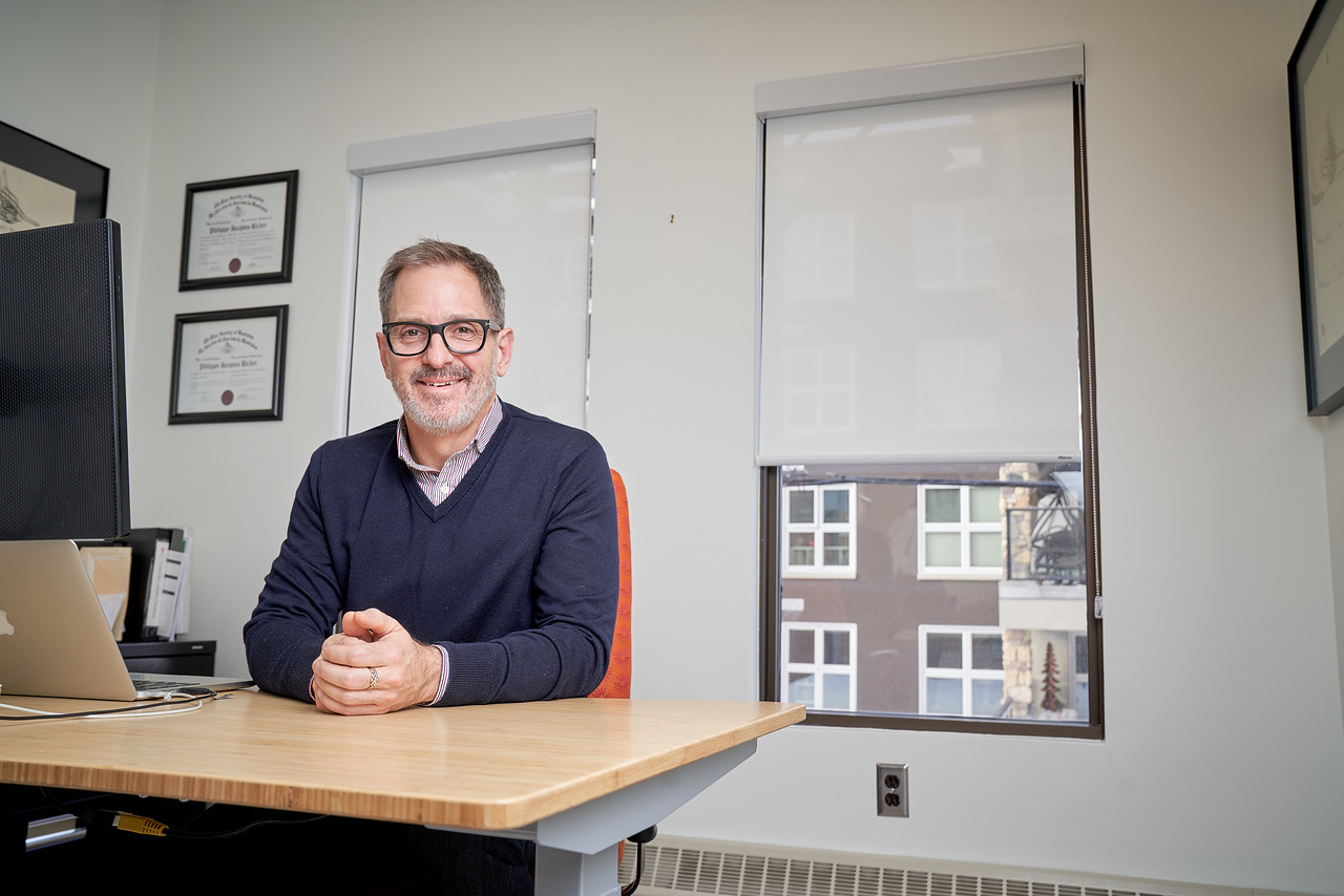 Philippe Richer, Principal Lawyer, siting at his desk in the St. Boniface TLR Law location.