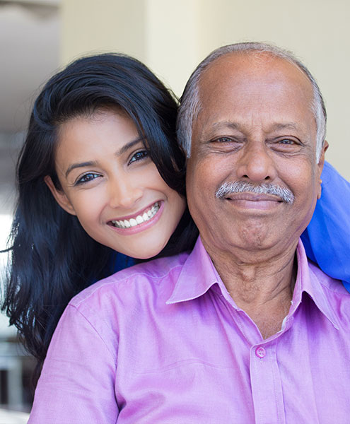 Man and his adult daughter, smiling