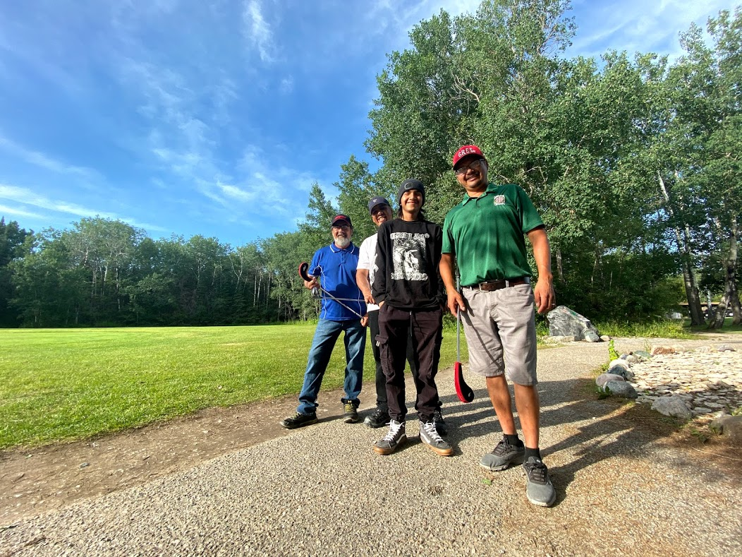 Four Manitoba Uske members networking at a game of golf
