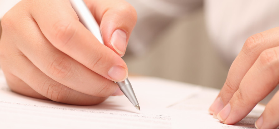 hand with pen writing