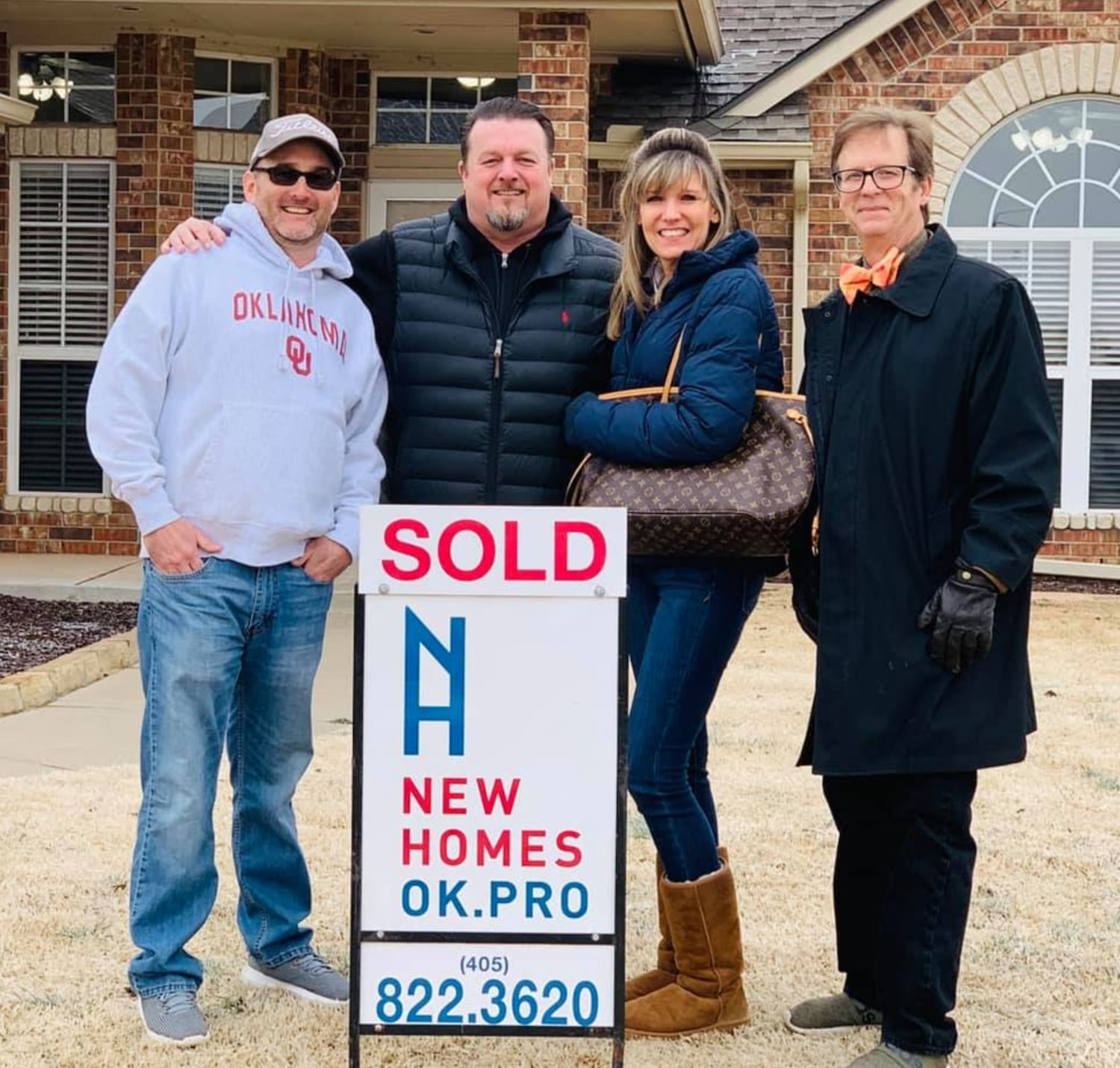 David Shapard and Brian Sloan with clients for NewHomesOK.com