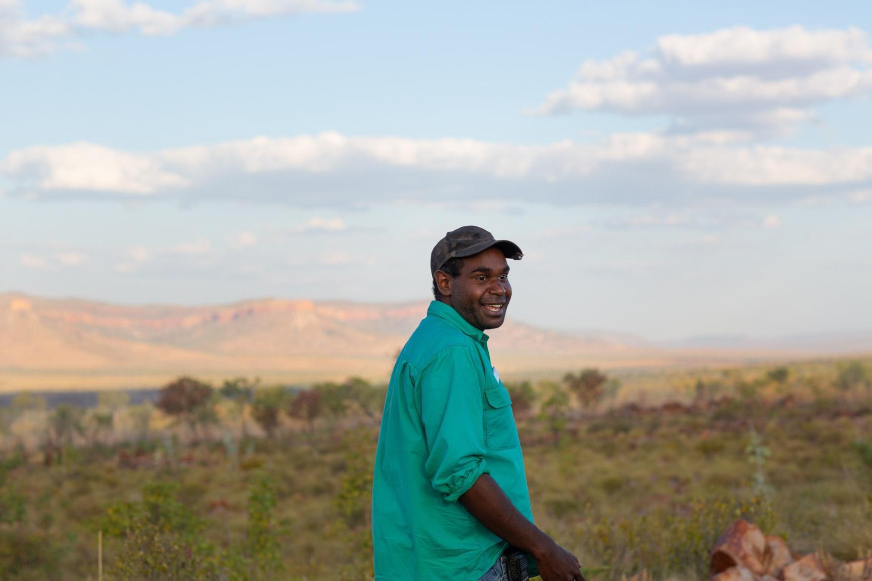 Aboriginal man wearing cap on Western Australian Landscape
