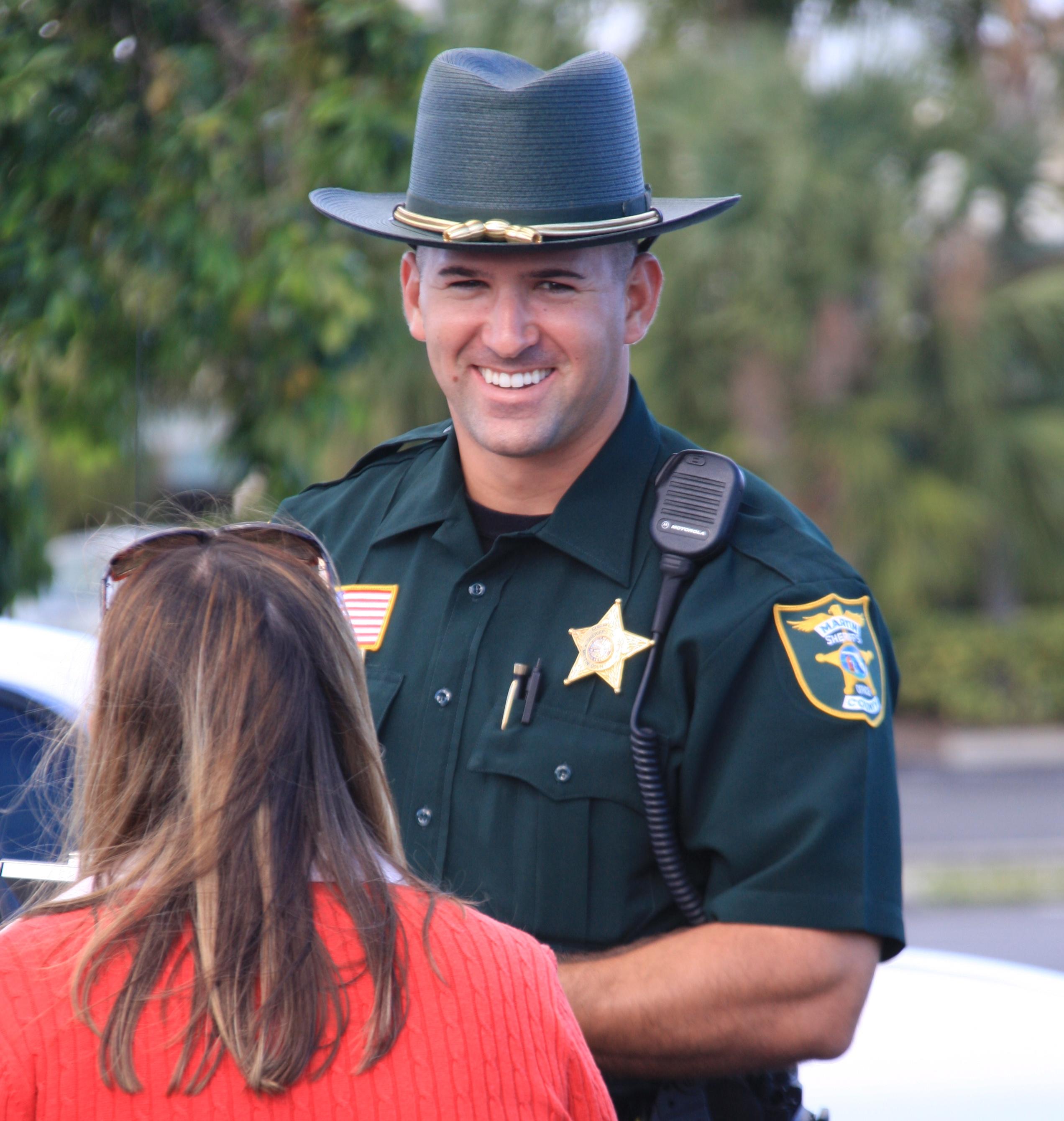 Florida sheriff smiling at woman