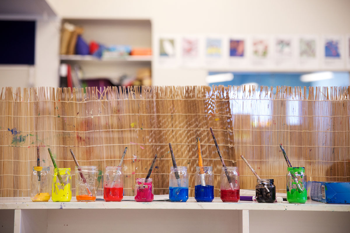 Colourful bottles on a table in a preschool