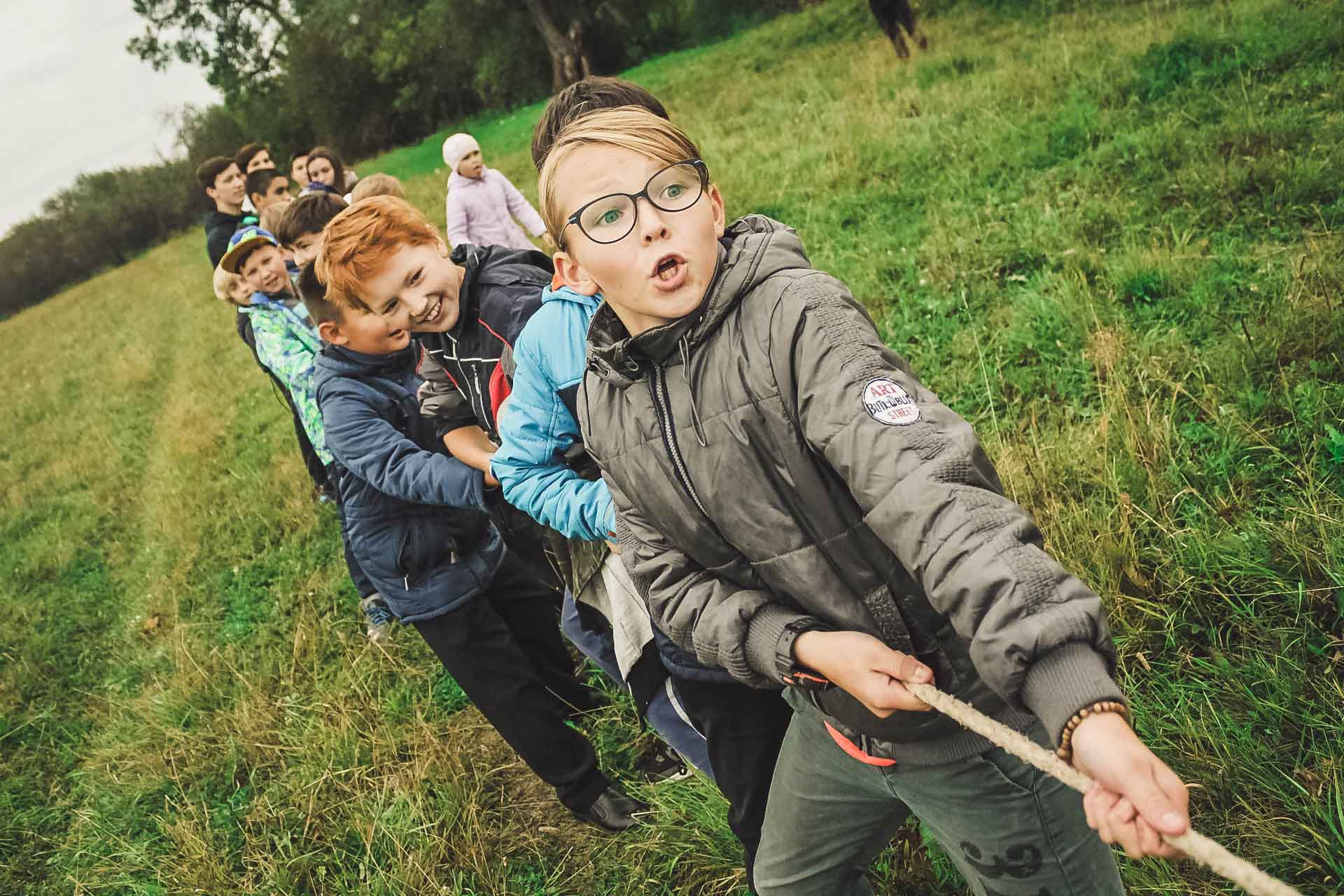 Children having fun in a tug-of-war