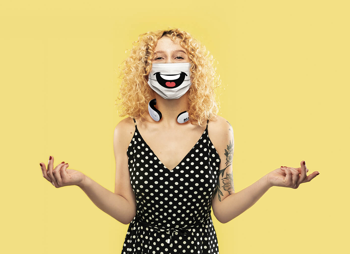 Young blonde woman wearing RIA and a face mask with a smile illustrated on