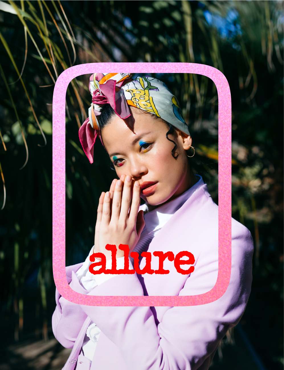 a woman wearing a silk head wrap with her hands gently touching her face and an Allure logo overlay
