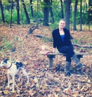Image of Sierra and her dog out in the woods