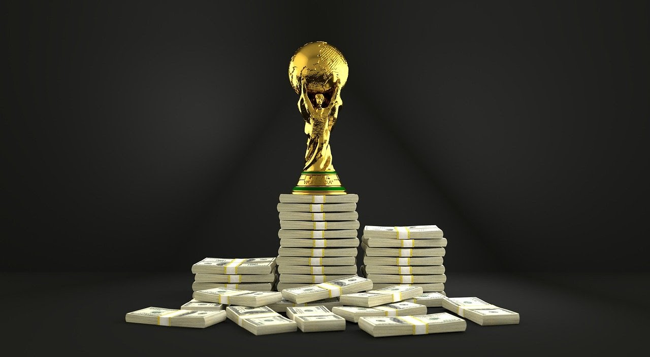 Trophy and money on black background