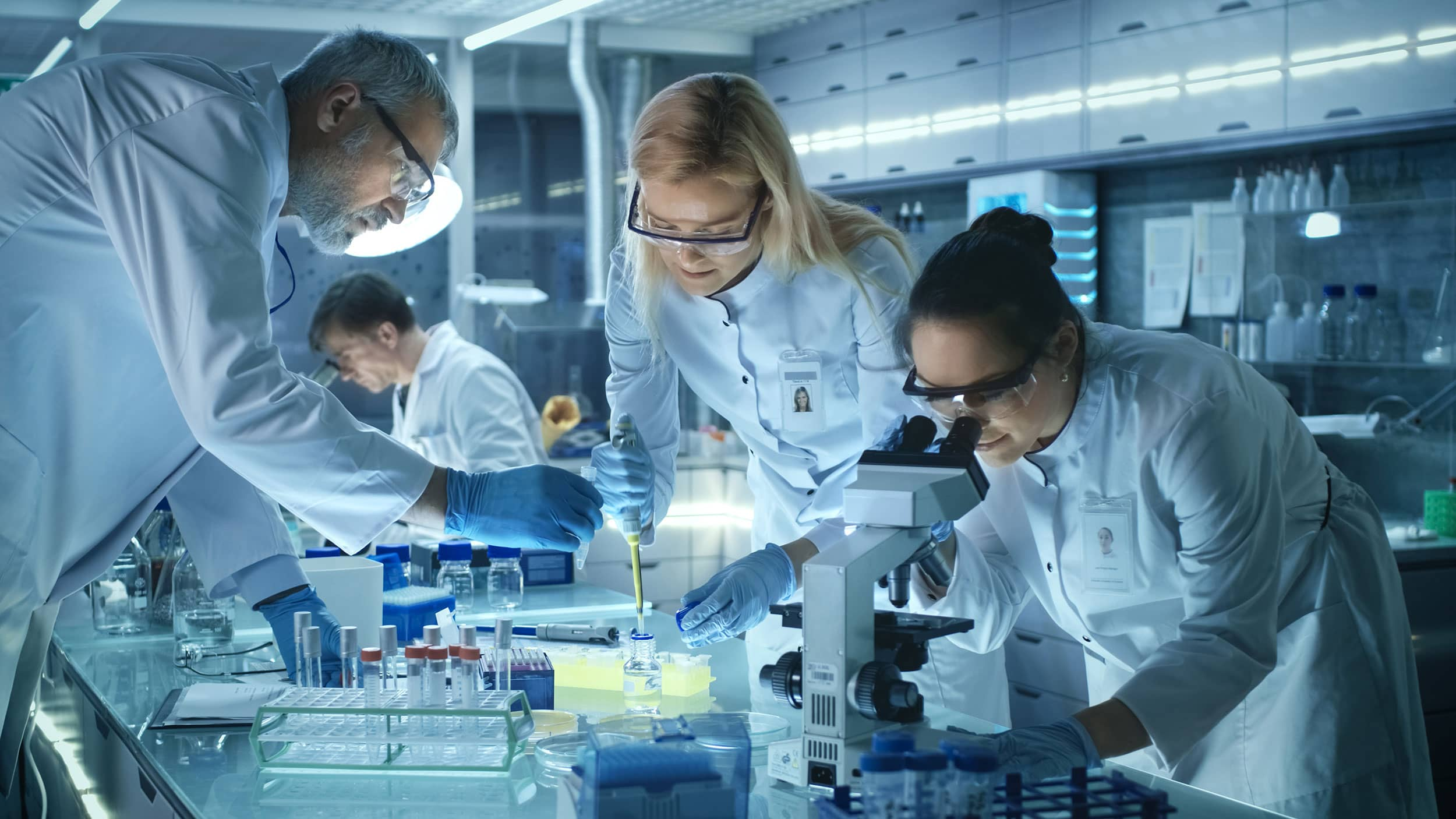 scientists looking at a sample