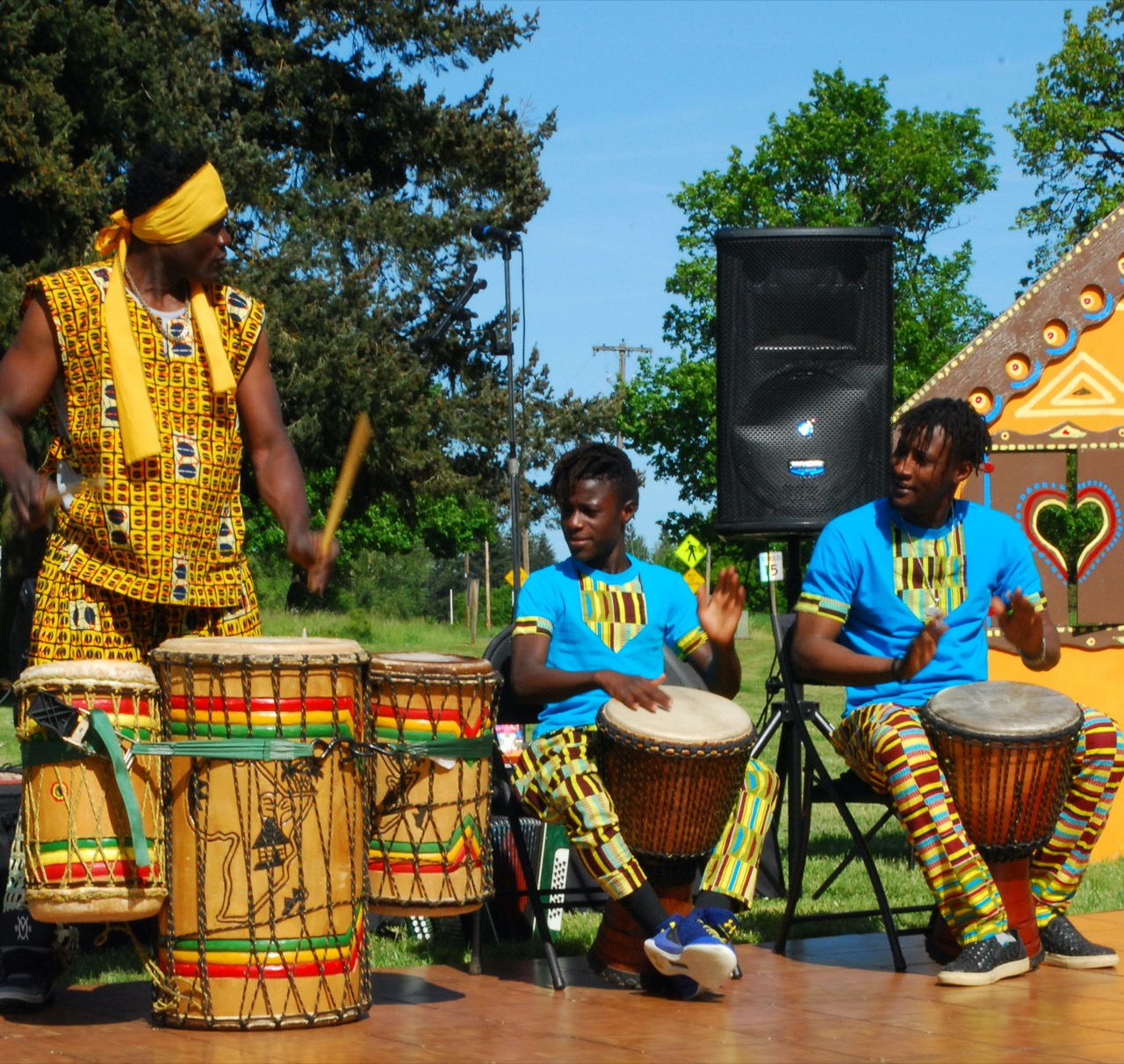 Alseny teaching a drumming class at West African Cultural Arts Institute