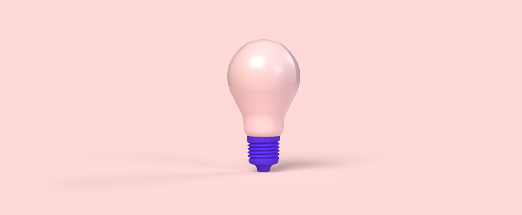 Pink light bulb on pink background