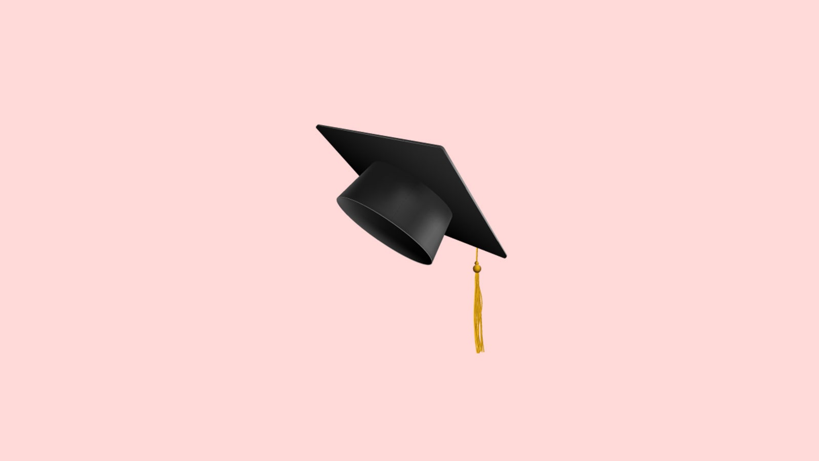 Graduation hat on a pink background