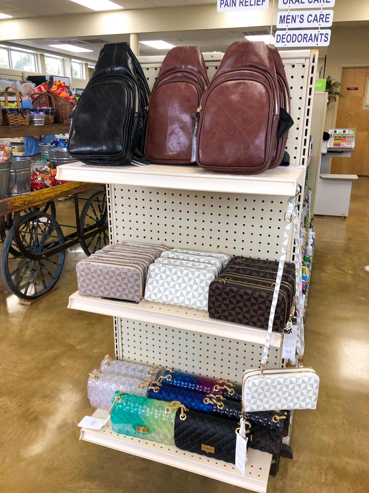 Shelf of different purse styles and sizes, including clutches.