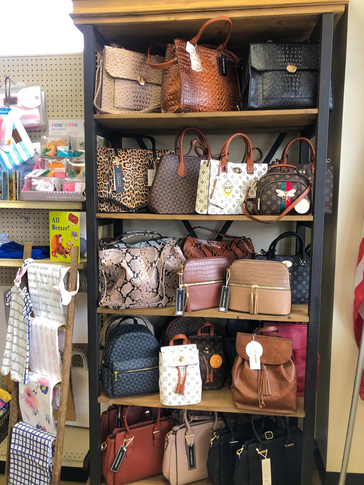 Shelf of different purse types and styles