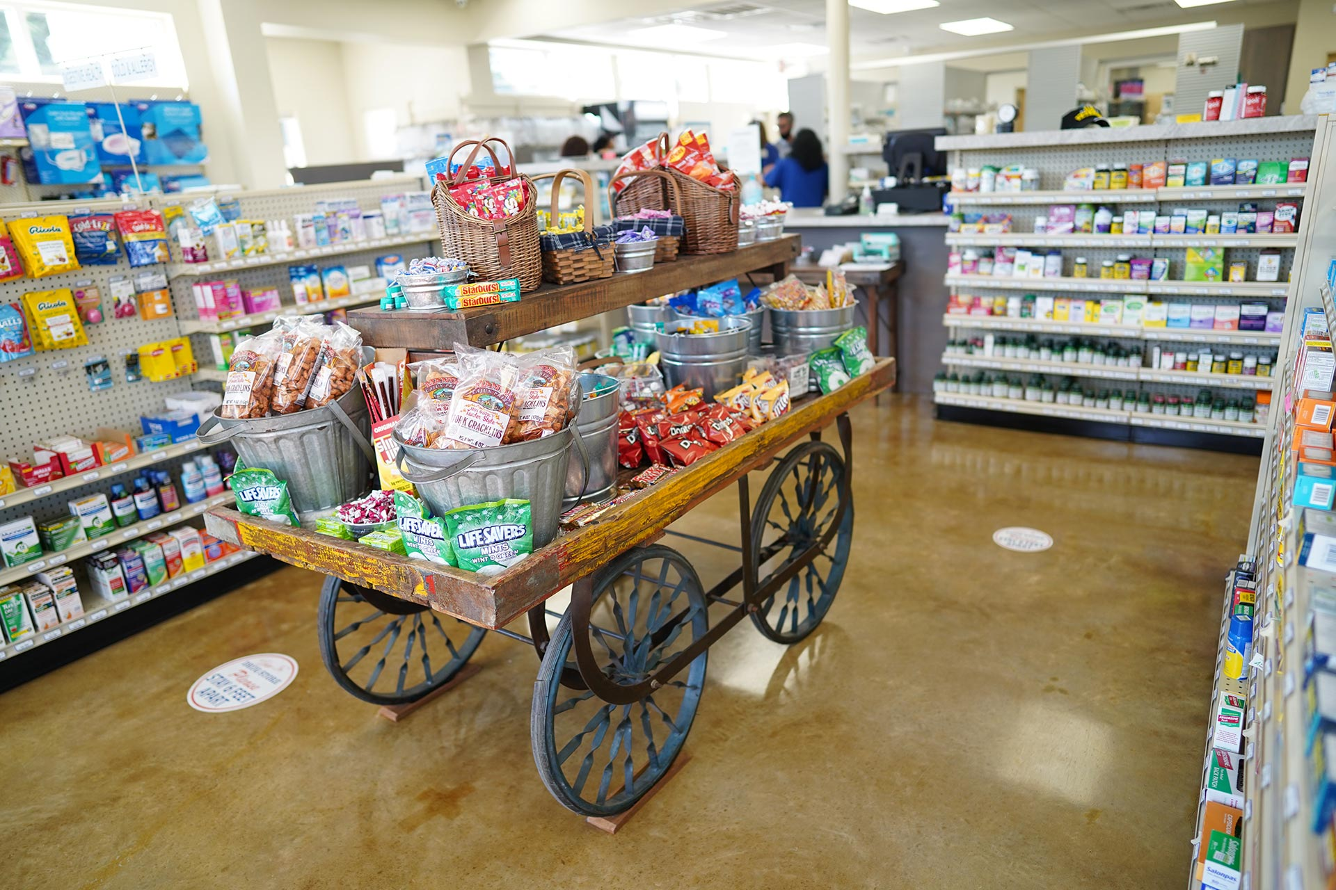Candy cart with a variety of treats and snacks like cracklins, chips, Skittles, and Starburst.