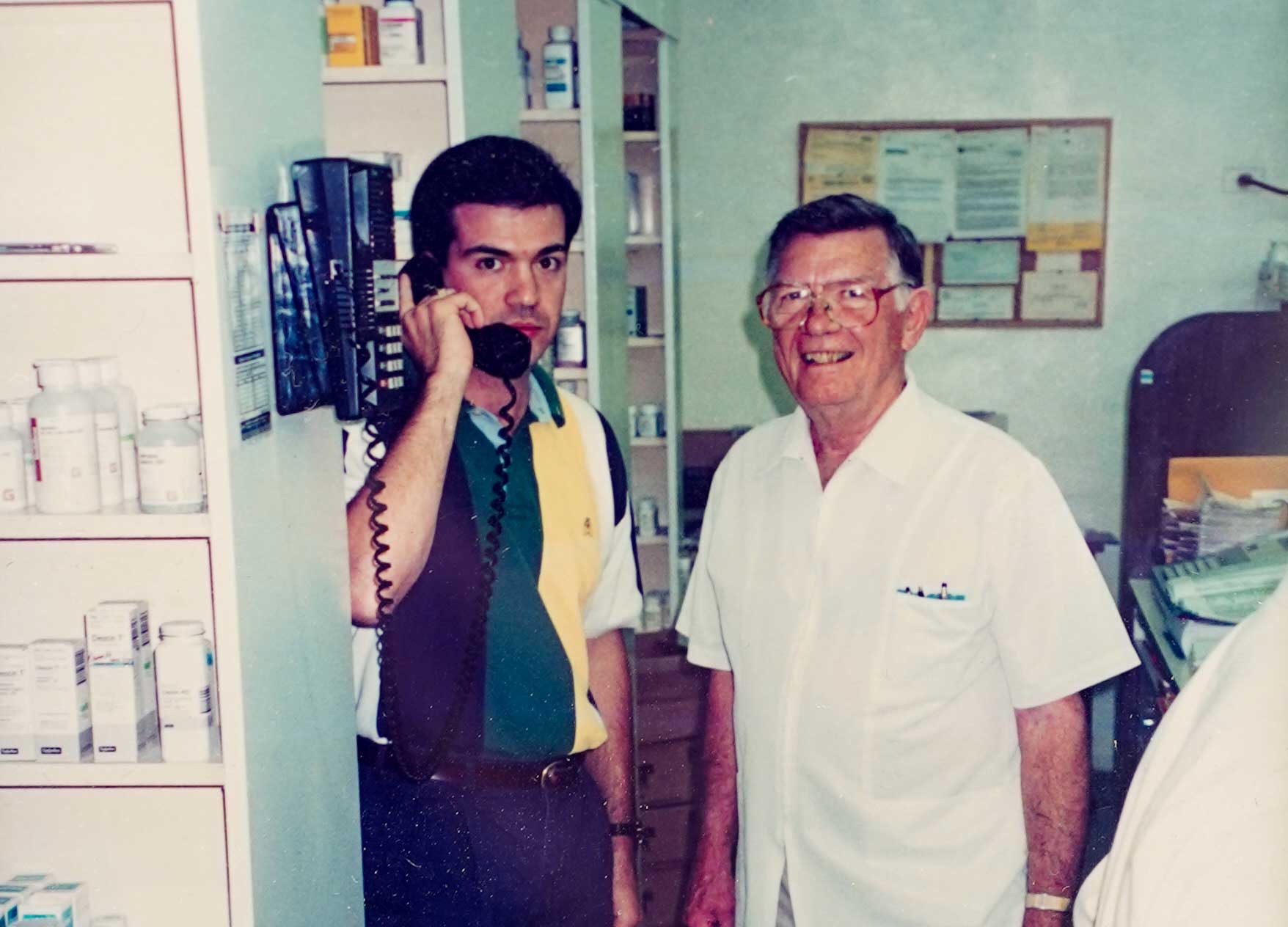 Old photo of Roy M. Stewart, Jr, the original owner of Drive-In Drug Store, and the current owner Gerald Giardina.