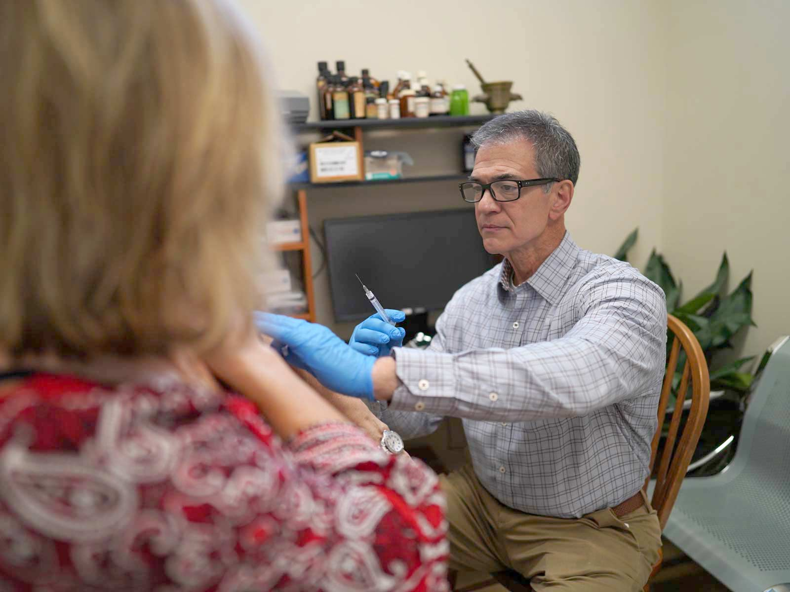 RPh Gerald Giardina preparing to give a immunization shot to a customer