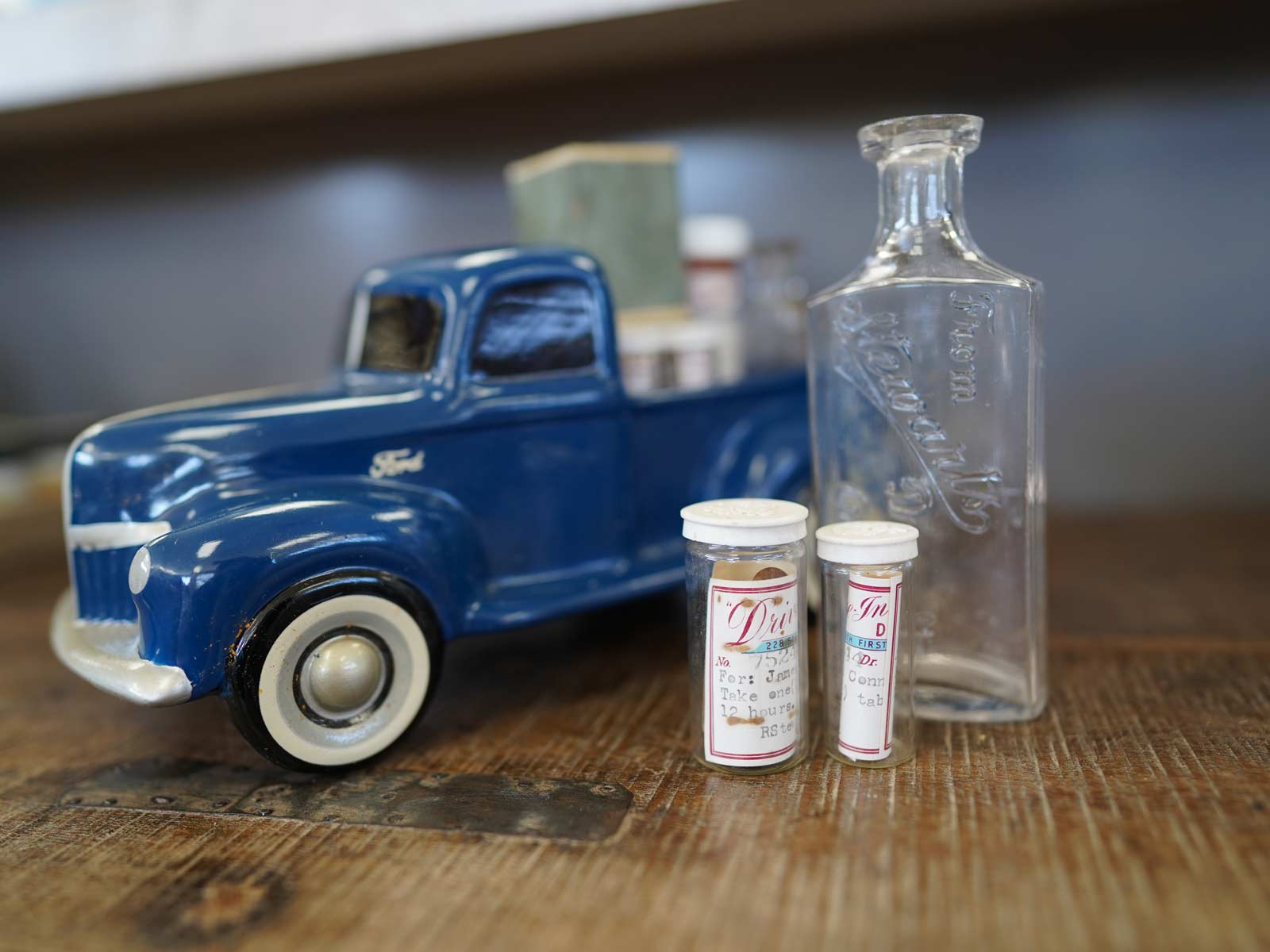 Classic Ford truck model and Drive-In Drug Store prescription bottles.