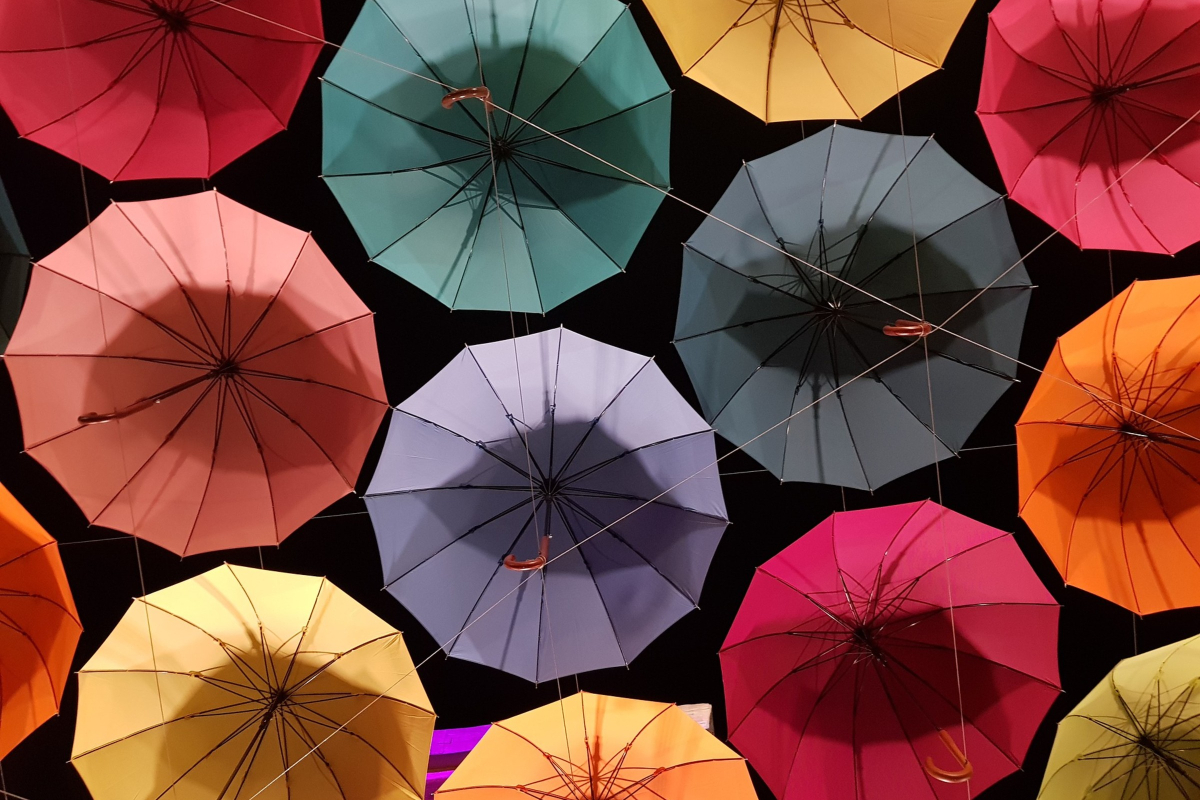 This is a photo of lots of colourful umbrellas representing comprehensive curriculum in relationships and sexuality education by Life Connections Ireland