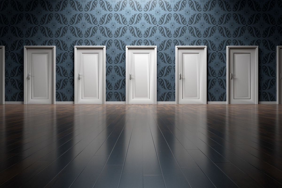 This is a picture of five identical white doors, representing choices in relationships and sexuality education by Life Connections Ireland