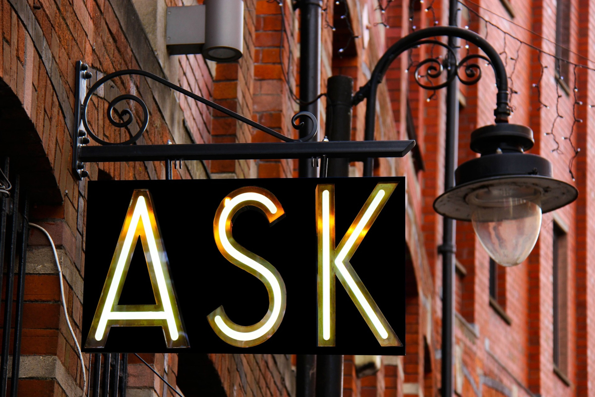 This is a sign hanging outside a shop that says ASK representing Consent in relationships and sexuality education by Life Connections Ireland