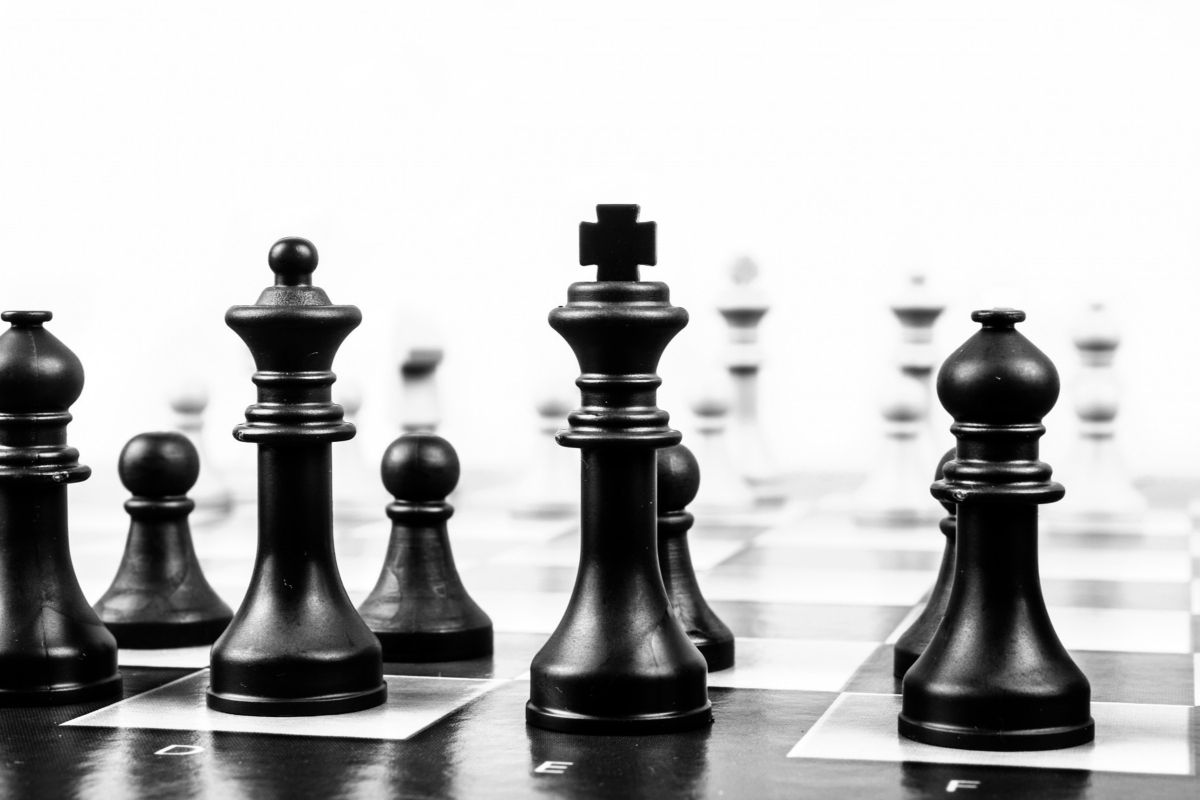 Chess pieces in black and white representing Confidence as a key skill to teach in relationships and sexuality education by Life Connections Ireland